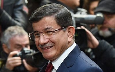Turkish Prime Minister Ahmet Davutoglu arrives for a summit on relations between the European Union and Turkey and on the migration crisis at the EU headquarters in Brussels on November 29, 2015. (AFP PHOTO / EMMANUEL DUNAND / AFP / EMMANUEL DUNAND)