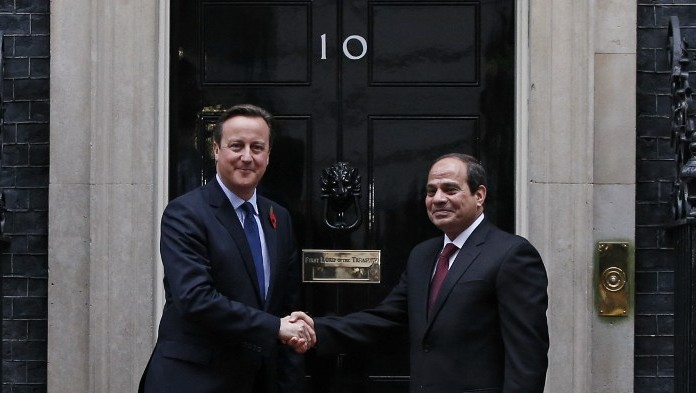 British Prime Minister David Cameron Shakes Hands With Egyptian President Abdel Fattah Al Sissi As