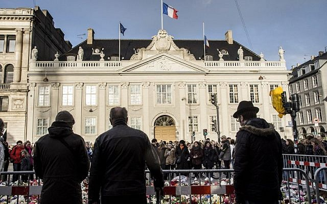 Flowers and candles are seen in front of the French embassy in Copenhagen on November 14, 2015 the day after a series of terrorist attacks in Paris. (AFP/SCANPIX DENMARK/Thomas Lekfeldt)