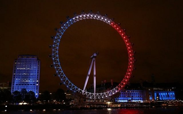 London landmark The London Eye is illuminated in blue, white and red lights, resembling the colors of the French national flag, in London on November 14, 2015 (Justin Tallis/AFP)