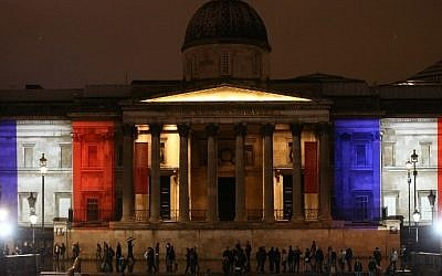 London's National Gallery is illuminated in blue, white and red lights, resembling the colors of the French national flag, in London on November 14, 2015, as Britons express their solidarity with France following a spate of coordinated attacks that left 129 dead in Paris on November 13. (Justin Tallis/AFP)