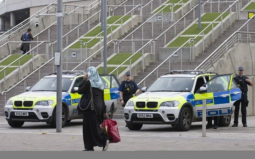 Armed British police officers stand guard outside Wembley Stadium in west London, on November 17, 2015, ahead of the international friendly football match between England and France later in the day. (Justin Tallis/AFP)