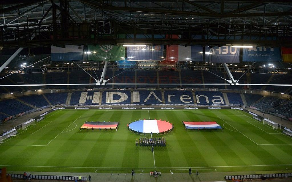 German, French and Dutch flags are seen during a rehearsal prior to a friendly football match between Germany and the Netherlands in Barsinghausen, Germany on November 17, 2015. (AFP PHOTO/DPA/ PETER STEFFEN)