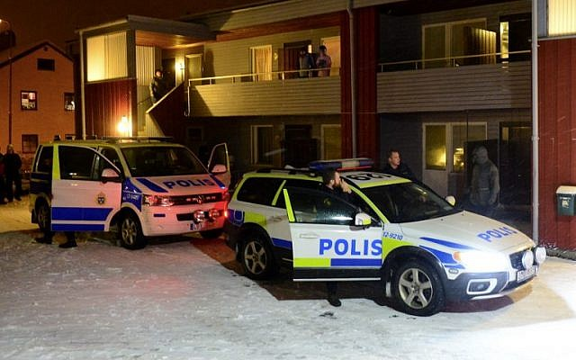 Illustrative: Swedish police stand by police cars outside a house used as a temporary shelter for asylum seekers in Boliden in northeastern Sweden on November 19, 2015, after police raided the house. (AFP/ TT NEWS AGENCY  / ROBERT GRANSTROM)