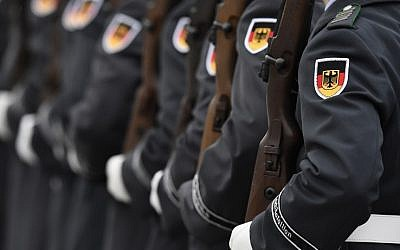 German Bundeswehr soldiers of an honor guard are pictured during a welcoming ceremony at the Defense Ministry in Berlin November 27, 2015. (AFP/ TOBIAS SCHWARZ)
