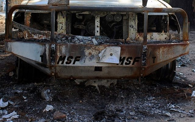 In this photograph taken on November 10, 2015, a burnt-out vehicle of the Doctors Without Borders medical charity is seen inside the premises of the group's hospital in Afghanistan's northern Kunduz, bombed by US troops in the previous month. (AFP Photo/Najim Rahim)