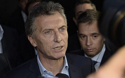 Argentine President-elect Mauricio Macri speaks to the press at the Olivos presidential residence in Buenos Aires, where he arrived to meet outgoing president Cristina Fernandez de Kirchner to define the transition, on November 24, 2015. (Juan Mabromata/AFP)