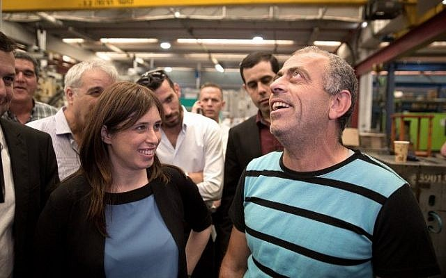 Deputy Foreign Minister Tzipi Hotovely (L) talks with a Palestinian worker on November 3, 2015 as she visits the Lipski plastic factory at the Barkan Industrial Park near the Israeli settlement of Ariel in the West Bank, after the European Union's (EU) decision to label goods made in Jewish settlements. (Menahem Kahana/AFP)
