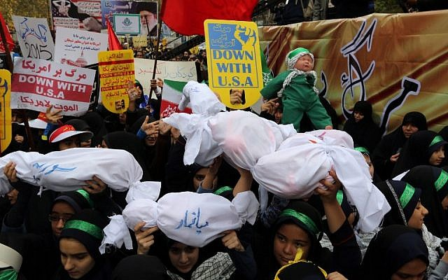 Iranian women and children carry  placards and dummies outside the former US embassy in the Iranian capital Tehran during a demonstration marking the anniversary of its storming by student protesters that triggered a hostage crisis in 1979, November 4, 2015. (Photo by AFP Photo / Atta Kenare)