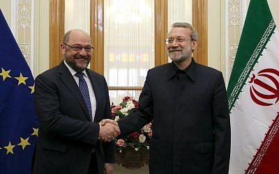 Iran's Parliament Speaker Ali Larijani, right, shakes hands with EU Parliament President Martin Schulz during a meeting in the capital Tehran on November 7, 2015. (AFP Photo/Atta Kenare)