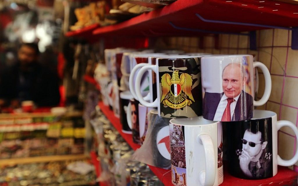 Mugs bearing portraits of Syrian President Bashar Assad and Russian President Vladimir Putin are seen on display at a shop in Hamidiya market in the Syrian capital, Damascus, on November 10, 2015 (AFP PHOTO/LOUAI BESHARA)