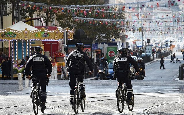 French police officers patrol on bike at the Canebiere in Marseille, on November 14, 2015. (AFP/ANNE-CHRISTINE POUJOULAT)