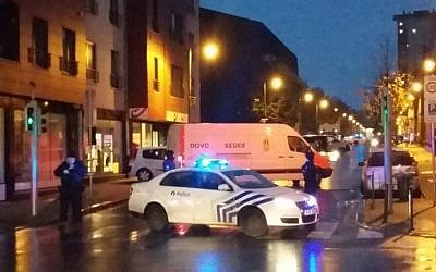 A cellphone photo taken on November 14, 2015 shows a van of the Belgian bomb disposal unit SEDEE as police block a street during a police raid in Brussels's Molenbeek district, possibly in connection with the November 13 deadly attacks in Paris. (AFP Photo/Belga/Hendrik Devriendt)