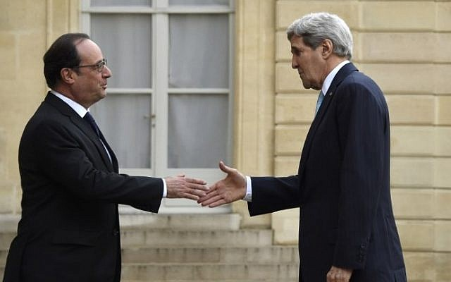 French President Francois Hollande, left, greets US Secretary of State John Kerry upon his arrival for their talks at the Elysee palace in Paris on November 17, 2015. (AFP/Dominique Faget)