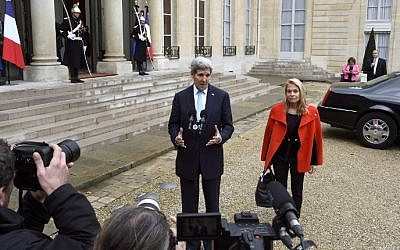 US Secretary of State John Kerry (L) and US Ambassador to France Jane Hartley address reporters following their meeting with the French President at the Elysee palace in Paris on November 17, 2015 (Dominique Faget/AFP)