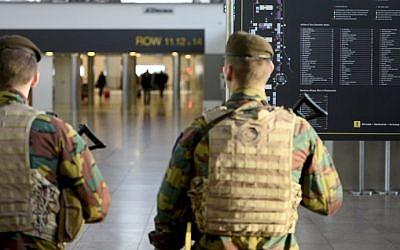Military police soldiers patrol the Brussels Airport on November 18, 2015 in Zaventem, eastern Brussels following a series of coordinated attacks by Islamic State jihadists in Paris on November 13 that killed at least 129 people. (AFP PHOTO/BELGA/DIRK WAEM)