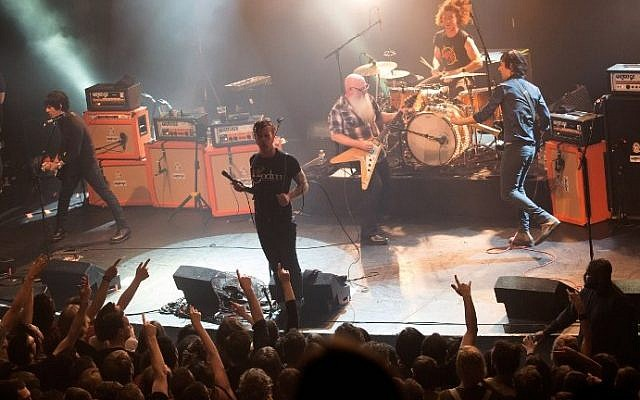 American rock group Eagles of Death Metal performing on stage at the Bataclan concert hall in Paris, France, a few moments before terrorists stormed into the venue and massacred 89 people, November 13, 2015. (AFP/ROCK&FOLK/Marion Ruszniewski)
