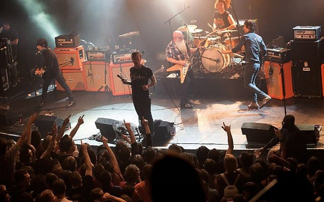File: American rock group Eagles of Death Metal performing on stage at the Bataclan concert hall in Paris, a few moments before men armed with assault rifles stormed into the venue killing 89 people, November 13, 2015. (AFP Photo/Marion Ruszniewski)