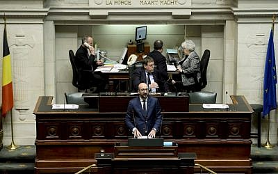 Belgian Prime Minister Charles Michel delivers a speech on the terrorist attacks in Paris at an extra plenary session of the Chamber at the Federal Parliament in Brussels on November 19, 2015. (AFP PHOTO/BELGA/DIRK WAEM)