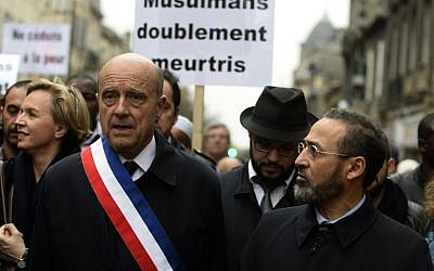 "French imam of Bordeaux's mosque Tareq Oubrou and Mayor of Bordeaux Alain Juppe attend a gathering in Bordeaux on November 20, 2015 as part of a public tribute to the victims of the November 13 Paris attacks. Oubrou has called muslims to ""change the way of thinking"" and ""to disconnect from a besieged culture"", considering mosques as ""the next step"" of terrorism. (Photo by AFP Photo / Jean-Pierre Muller)"