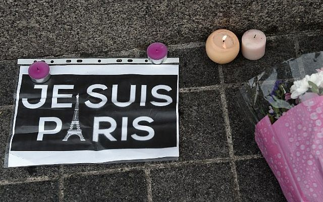 This photo taken on November 14, 2015 in Strasbourg, eastern France, shows a memorial of flowers and candles following a series of terrorist attacks resulting in the death of at least 120 people in Paris on November 13.   (AFP PHOTO/FREDERICK FLORIN)