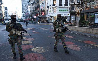 Belgian troops patrol a street in Brussels on November 23, 2015, as the Belgian capital remains on the highest possible alert level. (AFP/Emmanuel Dunand)