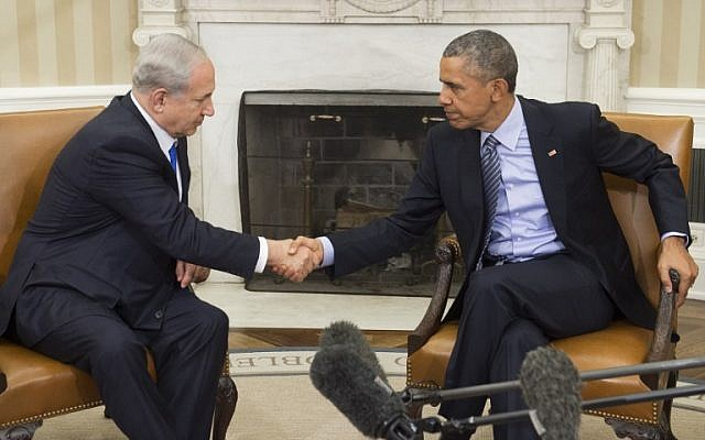 US President Barack Obama (right) and Prime Minister Benjamin Netanyahu shake hands during a meeting in the Oval Office of the White House in Washington, DC, November 9, 2015. (AFP/Saul Loeb)