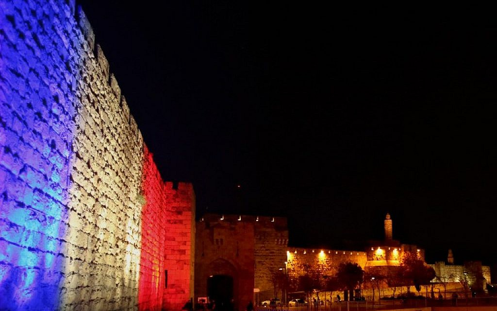 Jerusalem's Old City Walls are illuminated in red, white and blue, the colors of the French flag, in Jerusalem, November 15, 2015. (Photo by AFP Photo / Gali Tibbon)