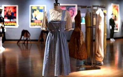 A Judy Garland-worn 'Dorothy' dress from The Wizard of Oz is displayed during a press preview on November 19, 2015 in New York (AFP PHOTO / TIMOTHY A. CLARY)