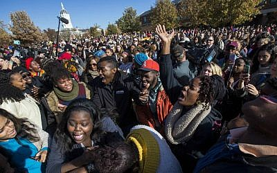 Protesters celebrate on campus after the resignation of University of Missouri president Timothy Wolfe, November 9, 2015 in Columbia, Missouri. (Brian Davidson/Getty Images/AFP)