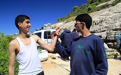 Muhammad Ziad Sabateen, left, poses for a photograph with a friend. (Courtesy)