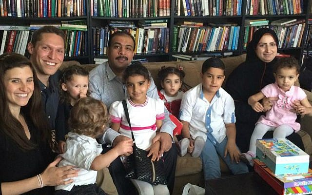 Rabbi Shmuly Yanklowitz (second from left), his wife Shoshana and two children host a newly arrived Syrian refugee family to Phoenix for Thanksgiving, November 26, 2015. (Courtesy)