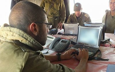 "Illustrative: IDF soldiers using the ""Hunter"" [Tsayad] system. The acronym stands for Digitized Land Army. The system allows multi-tier communications across encrypted platforms and has revolutionized the way combat unit receive and process intelligence. (Courtesy IDF)"