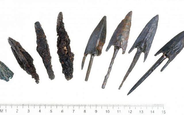 Lead sling stones and bronze arrowheads stamped with the symbol of the reign of Antiochus IV Epiphanes, evidence of the attempts to conquer the Acra citadel in Jerusalem's City of David in Maccabean days. (Clara Amit/courtesy of the Israel Antiquities Authority)