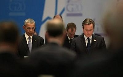 US President Barack Obama, left, and Britain's Prime Minister David Cameron join other leaders in a minute of silence for the victims of the Paris attacks prior to a session of the G-20 summit, in Antalya, Turkey, on November 15, 2015. (AP Photo/Lefteris Pitarakis)