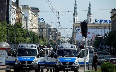 Illustrative photo of police forces in Warsaw, Poland (photo credit: CC BY Piotr Drabik, Flikr)