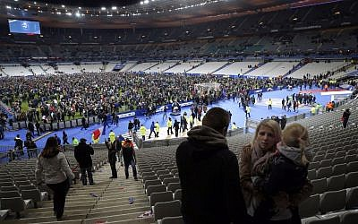 Supporters invade the pitch of the Stade de France stadium at the end of the international friendly soccer match between France and Germany in Saint Denis, outside Paris, November 13, 2015. (AP/Christophe Ena)