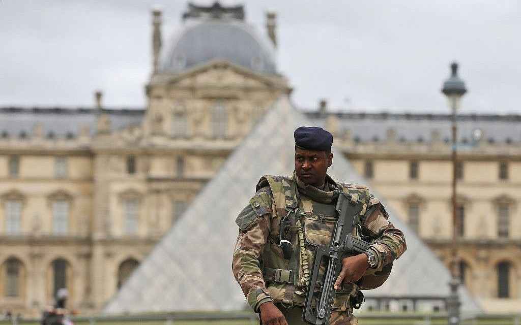 A soldier patrols in the courtyard of the Louvre Museum in Paris, Tuesday, November 17, 2015. (AP/Frank Augstein)