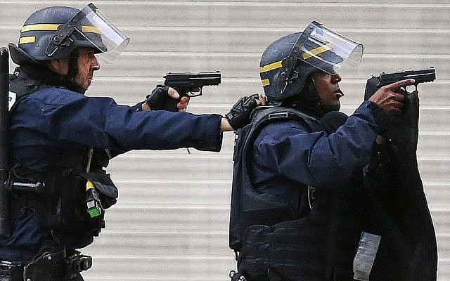 Police forces operate in Saint-Denis, a northern suburb of Paris, Wednesday, Nov. 18, 2015. (AP/Francois Mori)