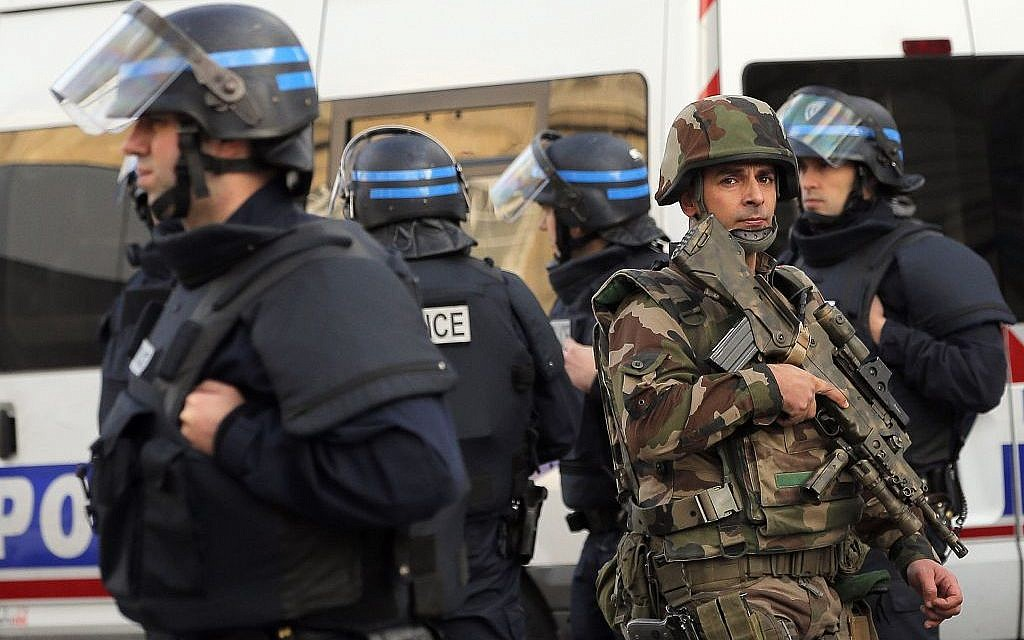 Police forces and soldiers patrol in Saint-Denis, a northern suburb of Paris, Wednesday, November 18, 2015.  (AP/Christophe Ena)