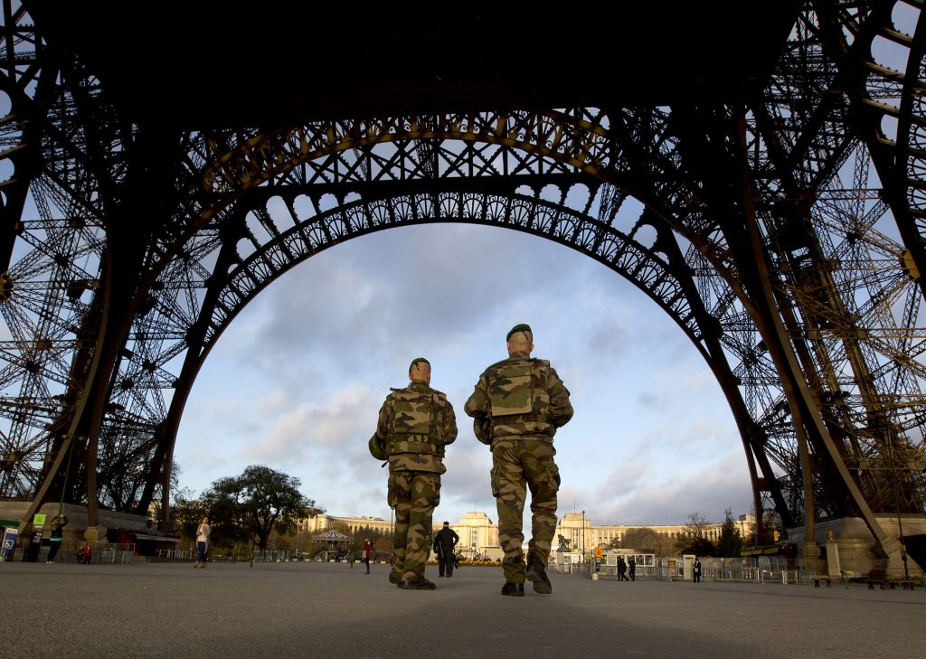 French soldiers patrol at the Eiffel Tower which remained closed on the first of three days of national mourning in Paris, Sunday, Nov. 15, 2015. (AP/Peter Dejong)