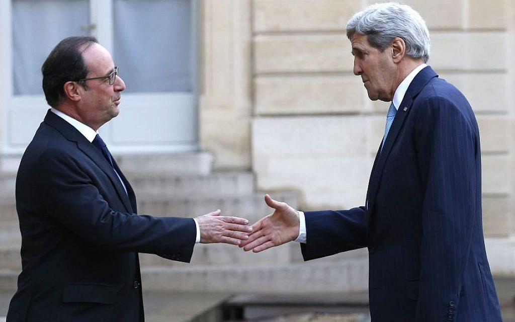 French President Francois Hollande, left, welcomes US Secretary of State John Kerry upon arrival at the Elysee Palace, in Paris, France, Tuesday, November 17, 2015. (AP/Francois Mori)