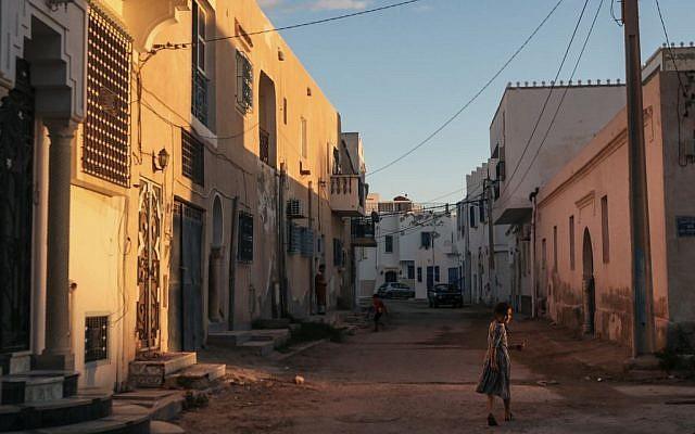 A girl walks home after sunset, at Hara Kbira, the main Jewish neighborhood on the Island of Djerba, southern Tunisia, October 29, 2015. (Photo by AP Photo/Mosa'ab Elshamy)