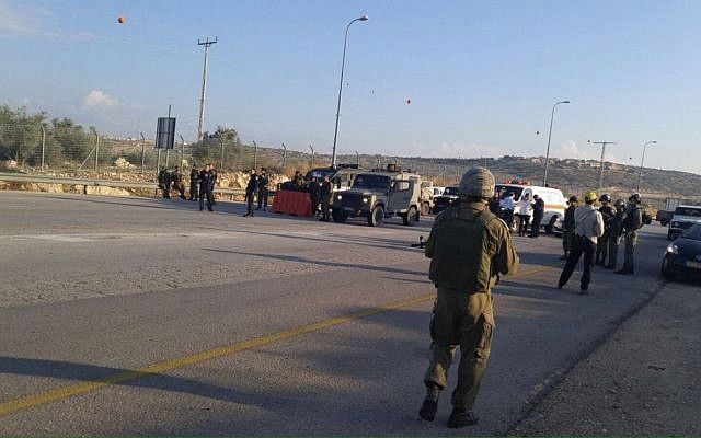 IDF soldiers at the site of a thwarted stabbing attempt, at the Eliyahu Crossing in the West Bank, on November 9, 2015. (Defense Ministry)