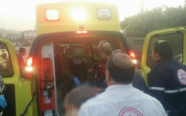 An injured Israeli man being taken by ambulance to a hospital in Jerusalem following a suspected car-ramming attack near Hebron, November 4, 2015. (Magen David Adom)