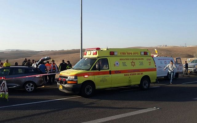 Ambulances arrive on the scene of a car-ramming attack at the Kfar Adumim Junction on November 27, 2015. (Courtesy Magen David Adom)
