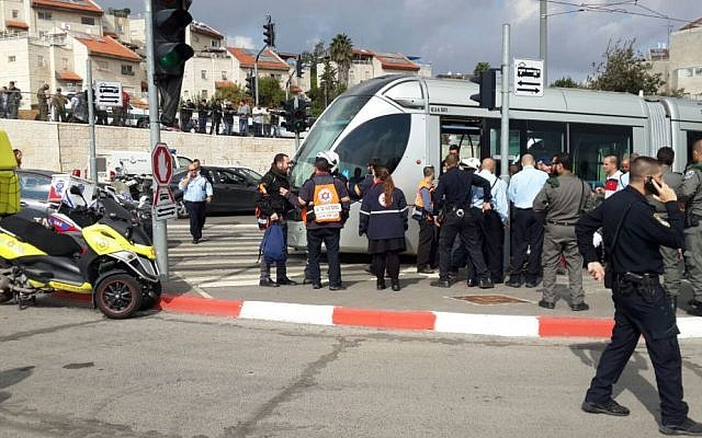Police, security guards and paramedics arrive on the scene of a stabbing attack on the light rail in the Pisgat Zeev neighborhood of Jerusalem on Nov. 10, 2015. (Magen David Adom)