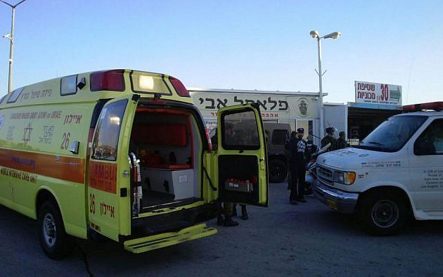 Magen David Adom ambulances arrive at the scene of a fatal stabbing attack on Route 443 outside of Jerusalem on November 23, 2015. (Magen David Adom)