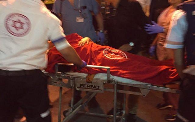 Medics provide medical care to victims injured in a stabbing attack in Kiryat Gat on November 21, 2015. (Magen David Adom)