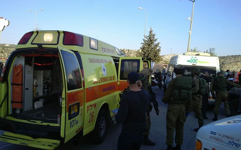 Magen David Adom ambulances arrive at the scene of a fatal stabbing attack on Route 443 outside of Jerusalem on November 23, 2015. (Magen David Adom)